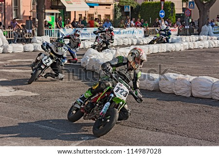 "LUGO, RA, ITALY - OCTOBER 6:  unidentified riders racing at ""II trofeo Lusa Moto"" for pit bike motard during the motorcycle festival ""Rombi di passione"" on october 6, 2012 in Lugo, RA, Italy"