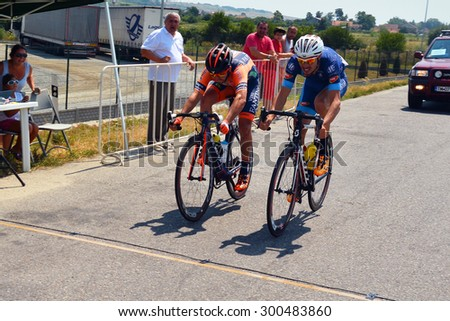 Lugoj, Romania - July 25, 2015: The winner of the Max Ausnit cup, Andrei Nechita (in blue) and the second position, Eduard Grosu, finishing the cycling competition. Shot taken on July 25th 2015  - stock photo