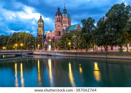 Lukaskirche St. Lukas pink church at dusk, Munich, Germany - stock photo