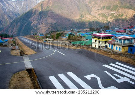 LUKLA, NEPAL - MARCH 4:  Tenzing-Hillary Airport  the most dangerous airport in the world on March 4, 2014 in Lukla, Nepal. - stock photo