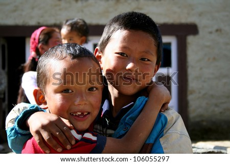 LUKLA, NEPAL -SEPTEMBER 29: Unidentified sherpa boys on September 29, 2006 in Lukla, Everest Region, Nepal. Sherpa are an ethnic group from Nepal, highly regarded as elite mountaineers.