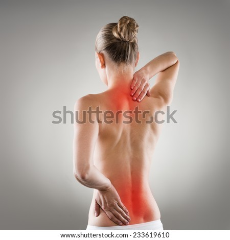 Lumbago and backbone stretch concept. Painful woman's back and neck indicated with red spot.  - stock photo