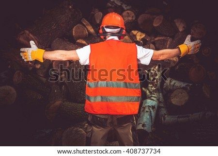 Lumber Worker of the Month Showing All Wood Logs He Cut. The Best Lumber Worker. Timber Industry Concept.  - stock photo