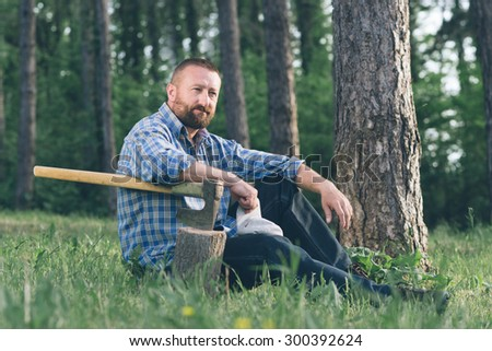 Lumberjack in forest. - stock photo