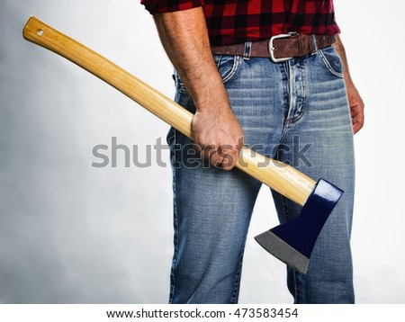 Lumberjack with plaid shirt in dark style