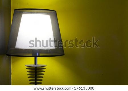 Luminous desk lamp i In a coffee shop somewhere in Bangkok - stock photo