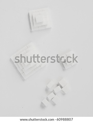 lump sugar, pyramids - stock photo