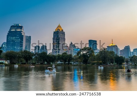 Lumphini park Bangkok downtown city in evening, Thailand
