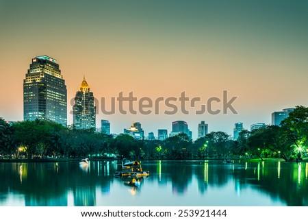 Lumphini park Bangkok downtown city in evening twilight, Thailand - stock photo