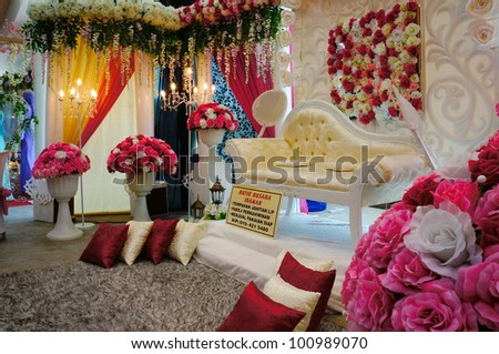LUMUT, MALAYSIA - APR 22: Decoration of Malay bridal throne with flowers from Busana Idaman Boutique during Perak Bridal Carnival at Marina Island Hall on Apr 22, 2012 in Lumut Perak, Malaysia. - stock photo