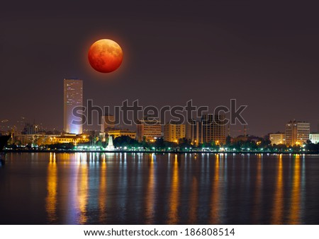 lunar eclipse next to Mersin - stock photo