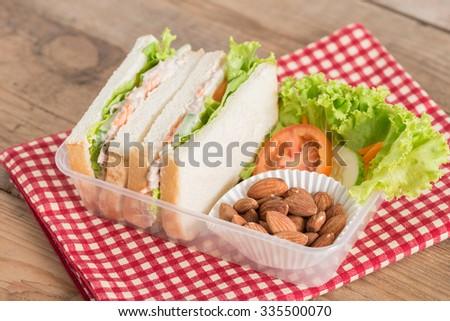 Lunch box, Tuna sandwiches with almond. - stock photo