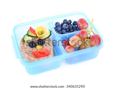 Lunch box with creative sandwich and fruits isolated on white background - stock photo