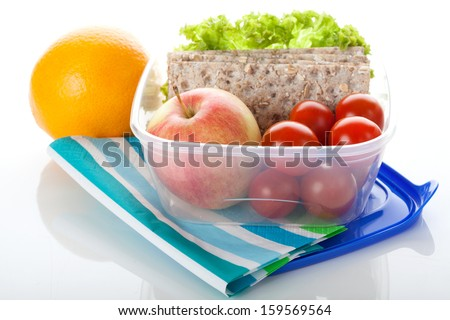 Lunch box with healthy food on white isolated background - stock photo