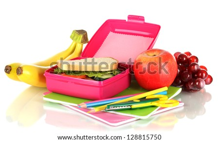 Lunch box with sandwich,fruit and stationery isolated on white - stock photo