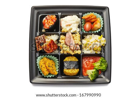 Lunch box with sushi and rolls isolated on white - stock photo