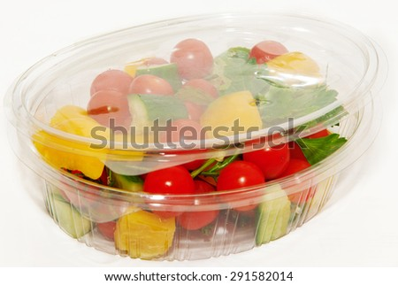 Lunch box with vegetable salad on a white background - stock photo