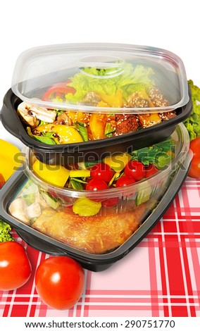 Lunch containers on a napkin with a vegetable salad and  Thai food - stock photo