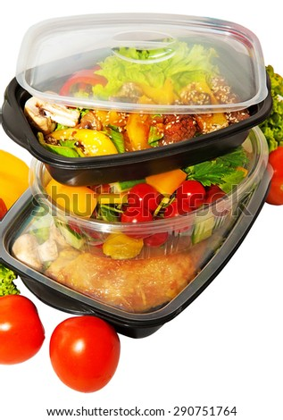 Lunch containers with vegetable salad and  Thai food - stock photo