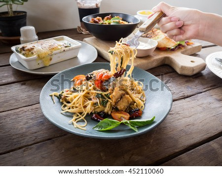 Lunch meals, Spicy spaghetti with mackerel, Spaghetti pasta with meatballs and Spinach Lasagna - stock photo