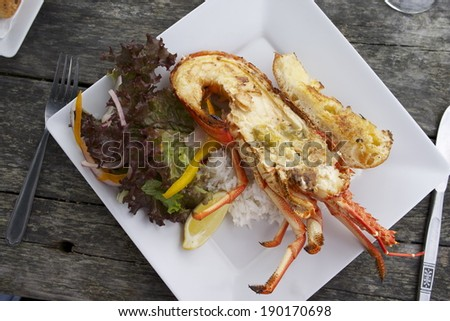 Lunch of Crayfish, at the roadside Caravan, Kaikoura New Zealand,Sth.Island. Taken March 2014 - stock photo