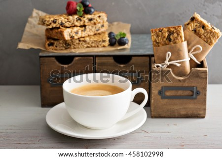 Lunch or snack to go for office or school granola bars, apples and coffee - stock photo