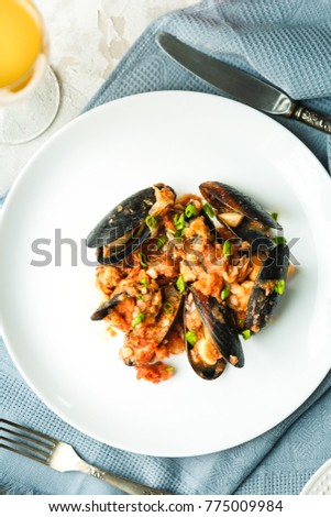 lunch with seafood: mussels with tomatoes and juice