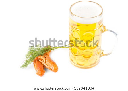 Lunchtime snack of a tankard of golden beer and fresh cooked prawns with a sprig of fresh dill