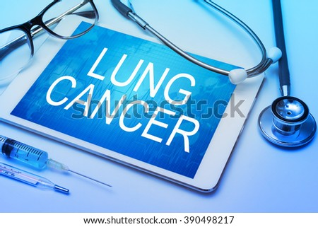 Lung cancer word on tablet screen with medical equipment on background