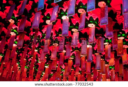 Lungta, ritual wish flags hanging inside of Buddhist Yakcheonsa Temple, Jeju Island, South Korea - stock photo