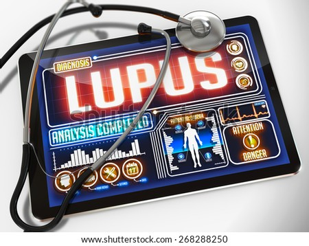 Lupus - Diagnosis on the Display of Medical Tablet and a Black Stethoscope on White Background.