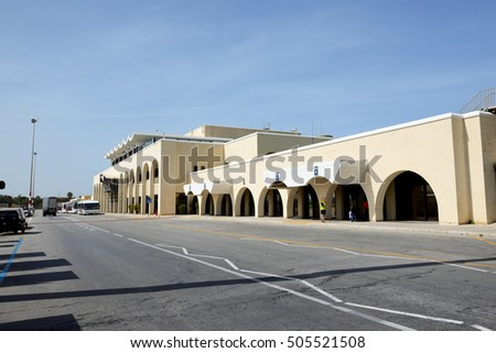 LUQA, MALTA - APRIL 18: The building of Malta International Airport on April 18, 2015 in Luqa, Malta. More then 1,6 mln tourists is expected to visit Malta in year 2015.