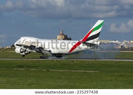 Luqa, Malta December 4, 2014: Emirates SkyCargo (TNT) Boeing 747-4HAF/ER/SCD touch down runway 31.  - stock photo