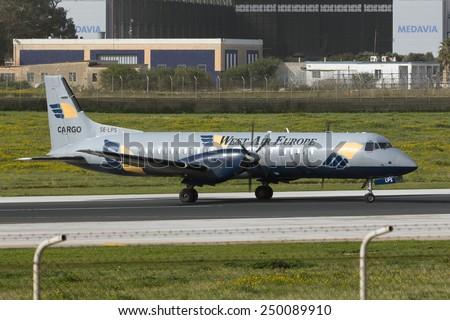 Luqa, Malta February 5, 2015: West Air Europe Cargo British Aerospace ATP making a 180 degree turn on runway 31 for departure. - stock photo