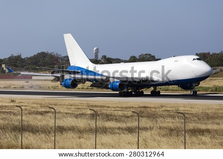Luqa, Malta May 22, 2015: Dubai Air Wing Boeing 747-412F/SCD landing runway 31, arriving from a long flight from Montevideo, Uruguay. - stock photo