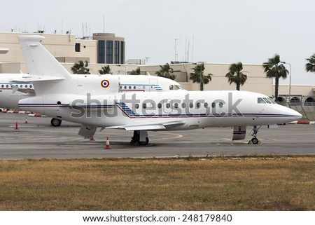 Luqa, Malta May 9, 2008: French Air Force Dassault Falcon 900 in apron 9, together with a French Air force A319 in the background. - stock photo