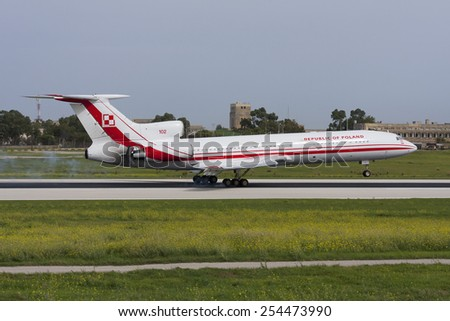 Luqa, Malta October 22, 2009: Polish Air Force Tupolev Tu-154M landing runway 14. Sister aircraft 101 crashed in Smolensk, Russia carrying the Polish President and high ranking officials in 2010. - stock photo