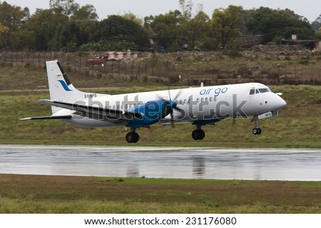 Luqa, Malta September 27, 2010: AirGo Airlines British Aerospace ATP(F) landing on a wet runway 31. - stock photo