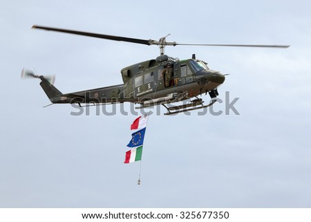 Luqa, Malta September 26, 2014: Italian Air Force Agusta AB-212AM based in Malta for a few years carrying the flags of Malta, Italy and Europe. - stock photo