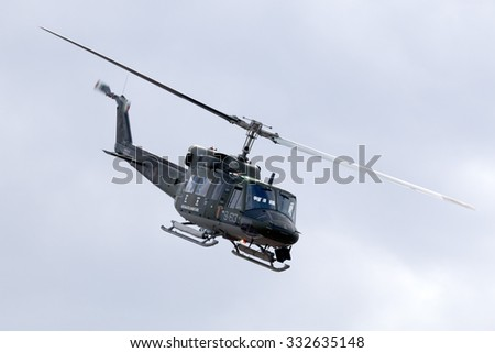 Luqa, Malta September 26, 2014: Italian Air Force Agusta AB-212AM based in Malta for a few years leaving the airfield after performing a rescue demonstration. - stock photo