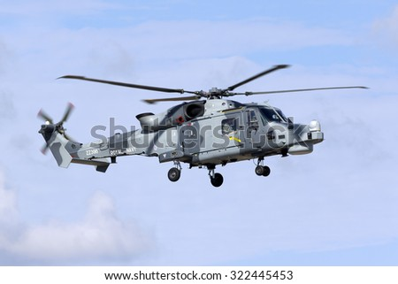 Luqa, Malta September 28, 2015: Royal Navy (Black Cats Display Team) Agusta Westland AW-159 Wildcat HMA2 performing some flights around the Maltese islands.