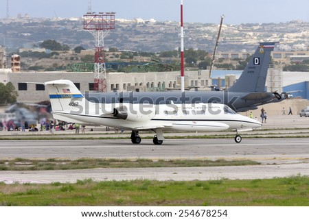 Luqa, Malta September 28, 2009: United States Air Force Gates Learjet C-21A (35A) departing runway 06, having participated in the Malta International Airshow the previous 2 days. - stock photo
