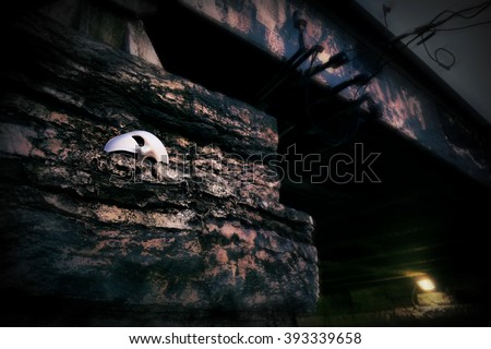 Lurking in the Shadows - Phantom of the Opera Mask on Vintage Bridge - stock photo