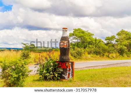 Lusaka, Zambia - April 5, 2015: Commercial advertisement for Coca Cola near Lusaka in Zambia - stock photo