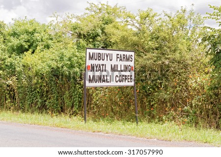 Lusaka, Zambia - April 5, 2015: Sign at the road pointing direction to Munali coffee farm, Nyati Milling and Mubuyu farms near Lusaka in Zambia. - stock photo