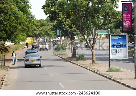 LUSAKA, ZAMBIA - DECEMBER 15, 2008: Daily traffic on the main boulevard in the capital city - stock photo