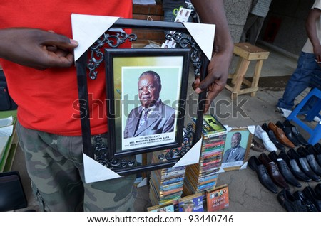 LUSAKA,ZAMBIA – DECEMBER 3:street peddler selling photo of president the republic of Zambia Chilufya, they use to hang photo president in many places,on December 3,2011 in Lusaka,Zambia - stock photo