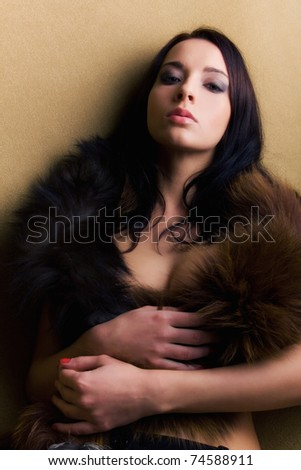 lust attractive glamor girl with brown boa