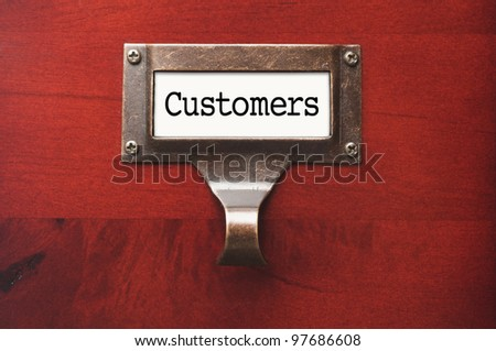 Lustrous Wooden Cabinet with Customers File Label in Dramatic LIght.