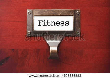 Lustrous Wooden Cabinet with Fitness File Label in Dramatic Light.
